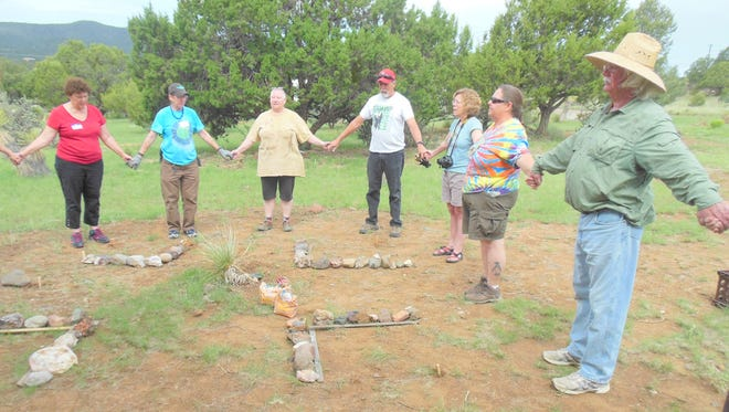 Unitarian Universalist Fellowship members hold hands and blessed their day's work.