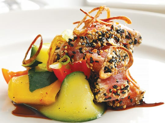 The tender and tasty seared yellowfin tuna came with a refreshing squash and heirloom tomato salad.