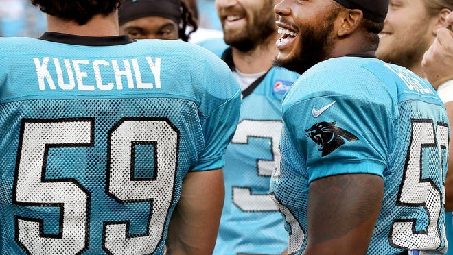 Zeek Bigger laughs with Carolina Panthers teammates like Luke Kuechly during the team's 2017 FanFest in Charlotte.