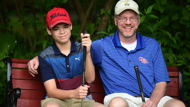 Owego residents Brendan Evans, 14, and his father Chris Evans, are avid golfers.