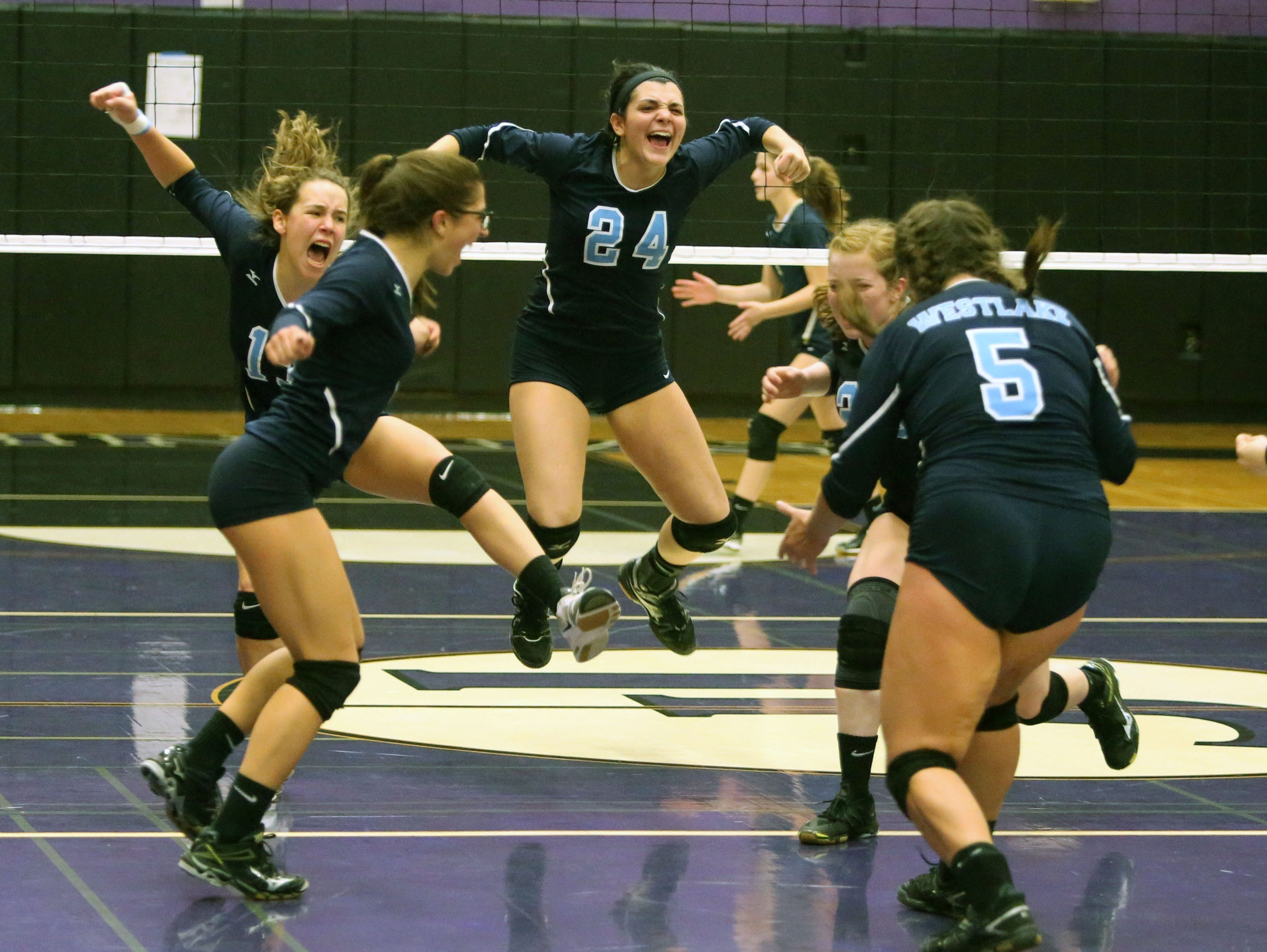 Westlake Captain Kelly Martin celebrates a point near the end of their match against Lourdes during the Section 1 Class B volleyball final at John Jay High School in Cross River, Nov. 5, 2016. Westlake beat Lourdes 3 games to 2.