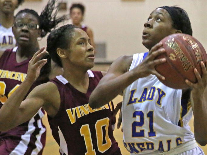 King's Kaye Clark looks to get past  Vincents Ce Ce