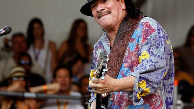 "Carlos Santana performing during the New Orleans Jazz and Heritage Festival. Santana's latest album, ""Corazon,"" debuted at No. 9 on the Billboard 200 albums chart."