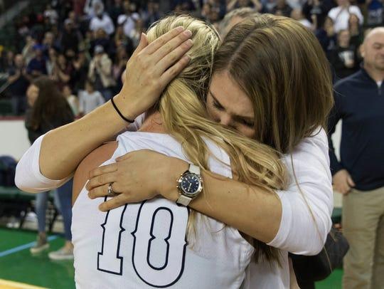 Manasquan's Dara Mabrey gets hugs from her coach Lisa