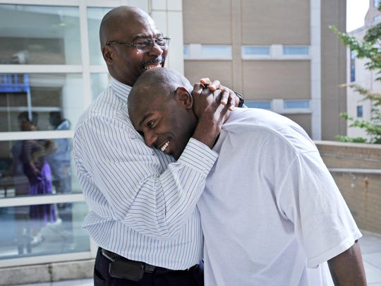 Robert Wilcoxson, right, is embraced by his father Robert Wilcoxson-Bey after being proclaimed innocent and released from prison after being jailed for 11 years on murder charges in 2011.