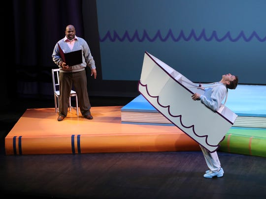 Alphaeus Green Jr, left, narrates as Matthew Brennan, right, performs as Harold in the Stage One performance of Harold and the Purple Crayon at the Kentucky Center.