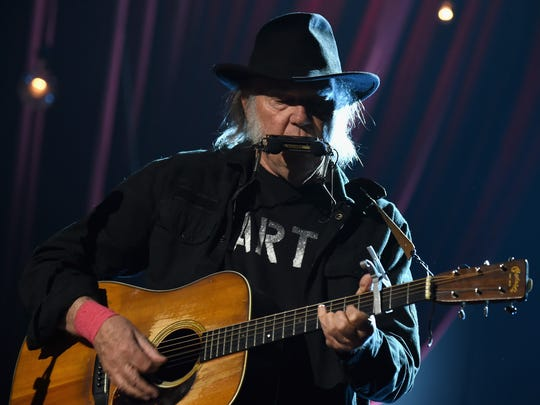 Neil Young performs onstage at the 25th anniversary