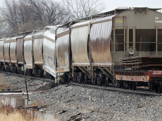 A train derailed early Friday morning near Riemer Road in Hilbert after part of the trestle washed out amid heavy rains.