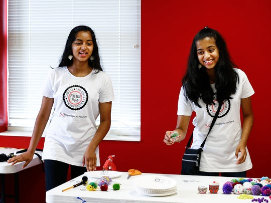 Collierville twin sisters Aanchal and Pallavi Singhal talk with campers during Mid-South Gifted Academy's Young Innovators Camp. The sisters helped students learn about their business, Pompom Depot, during an entrepreneurial session.