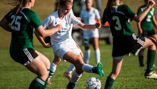 MMU's #14Devyn Beliveau-Gale tries to push through the  St. Johnsbury Academy defense during their soccer match up on Tuesday, Sept. 19, 2017, in Jericho. Mt. Mansfield Union High School won 2-0.