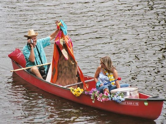 Paddlers creatively decorates their boats for the Historic Codorus Creek Boat Parade.