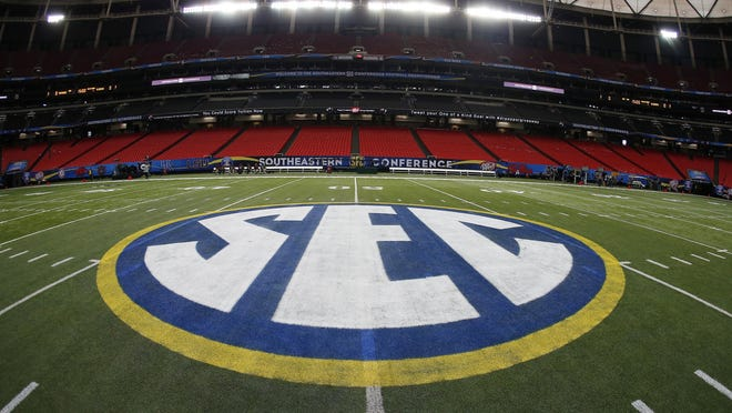 The SEC logo in 2014 in Atlanta ahead of the Southeastern Conference championship football game between Alabama and Missouri.