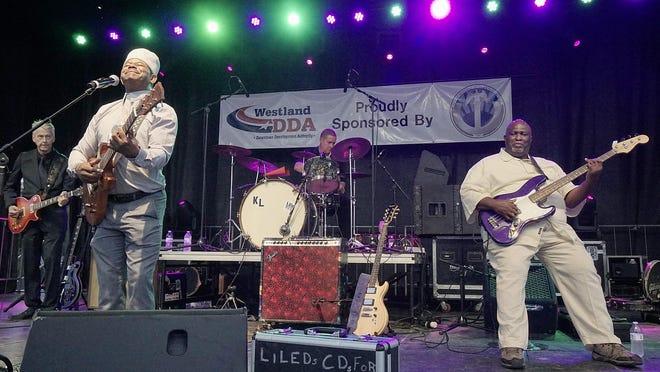 A band plays at Blues, Brews and BBQs.