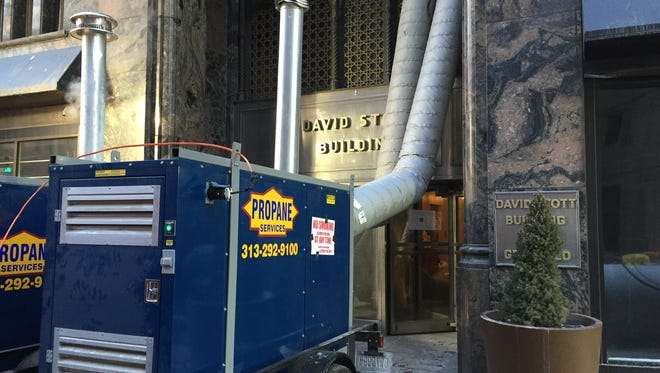 Crews are siphoning water from the David Stott building in downtown Detroit after a pipe burst, flooding lower levels with water.
