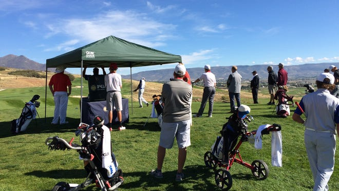 Golfers check in on Hole No. 1 at Soldier Hollow on Wednesday during the first day of the 3A state tournament.