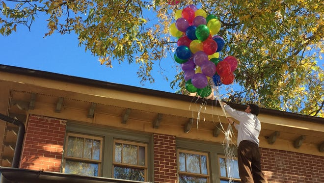 "Attorney Chace Campbell attempts to recreate the flying house from the movie ""Up."""