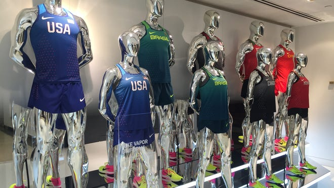 A display of Nike uniforms Olympic competitors will wear in Rio at a Nike store in Manhattan. Nike and other sports apparel retailers are hoping for a boost in sales as the Olympic games turn the country's attention to sports, and sports apparel.