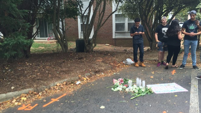 Flowers and candles were left at the site where Kevin Lamont Scott, 43, was shot in a police-involved shooting on Tuesday, Sept. 20, 2016.