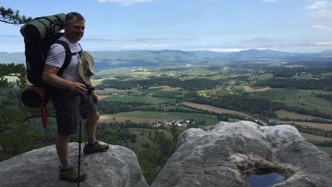 Nearing the end of our 3-day hike, I take in a view rural Virginia from a scenic rock outcropping along the Appalachian Trail.
