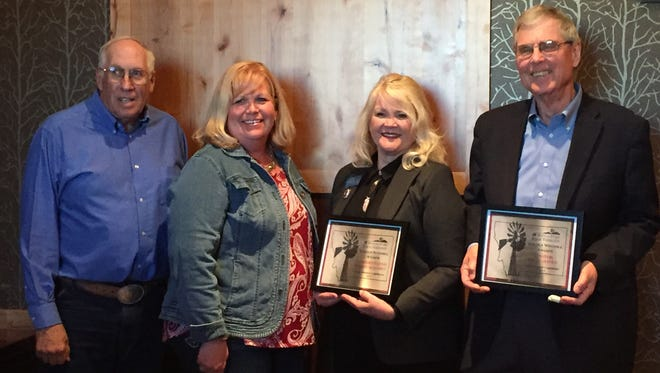 State legislators Wendy McKamey (center right) and Brian Hoven (far right) each received Golden Windmill awards from the Montana Farm Bureau at a ceremony on May 24. Shown with McKamey and Hoven are Cascade Co. Farm Bureau President, Jim Pribyl and Montana Farm Bureau Director Cindy Denning