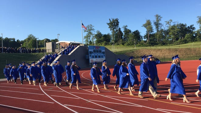 The Spring Grove Area High School Class of 2017 walks in procession on graduation day, June 6, 2017.