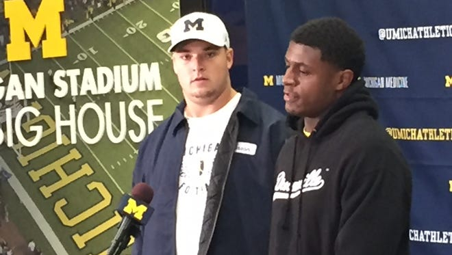 Michigan left tackle Mason Cole, left, and linebacker Mike McCray were introduced as Wolverines captains on Monday, Aug. 28, 2017.
