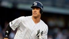 New York Yankees right fielder Aaron Judge (99) looks