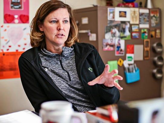 Melissa Kelly teaches her economics class April 8,
