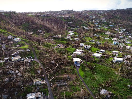 Damaged homes and trees stripped of their leaves are seen throughout Yabucoa, Puerto Rico, on Oct. 2, 2017, 11 days after Hurricane Maria struck the island.