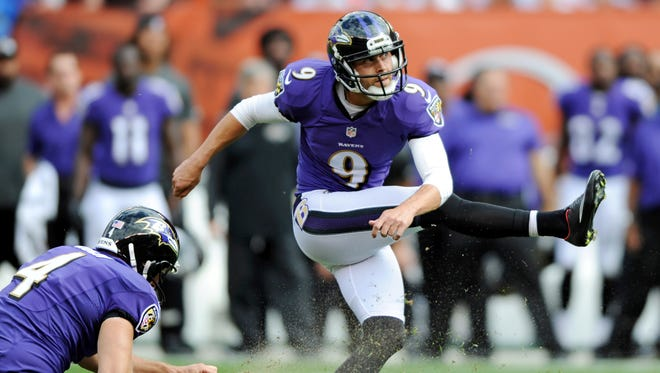 Ravens K Justin Tucker watches his game-winning field goal split the uprights in Cleveland on Sunday.