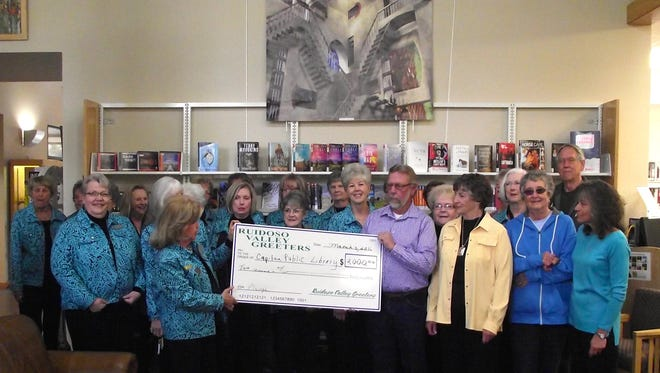 The Capitan Public Library  board receive a check awarded by the Ruidoso Valley Greeters at the Ruidoso Public Library March 3.