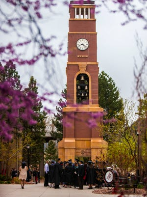 Graduates gather around the clock tower before Southern Utah's commencement, Saturday, April 30, 2016.