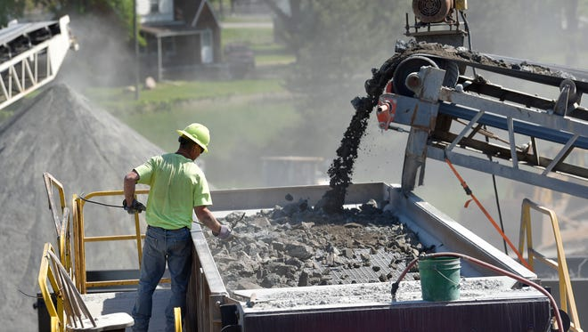 A proposed measure to repeal Michigan's prevailing wage law would affect road construction and other public building projects in the state.