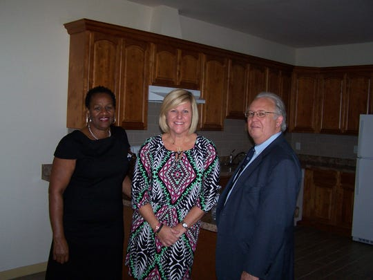 Fanwood Mayor Colleen Mahr (center); Geraldine Smith, the scheduler for Assemblyman Gerald Green; and Sid Blanchard, CAU executive director, tour the interior of the new facility on Terrill Road in Fanwood on Sept. 23.