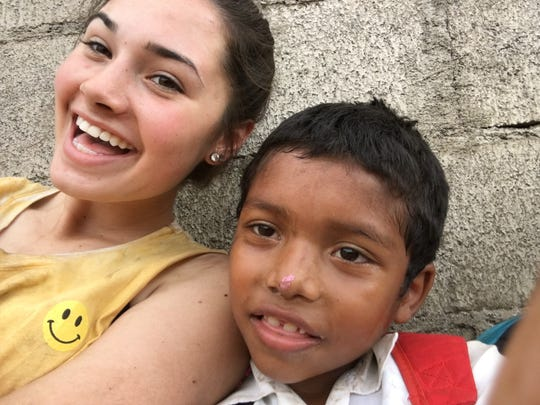 On their sixth day in Nicaragua, members of the St. Joseph Catholic School crew hung out with locals and took a break from digging trenches.