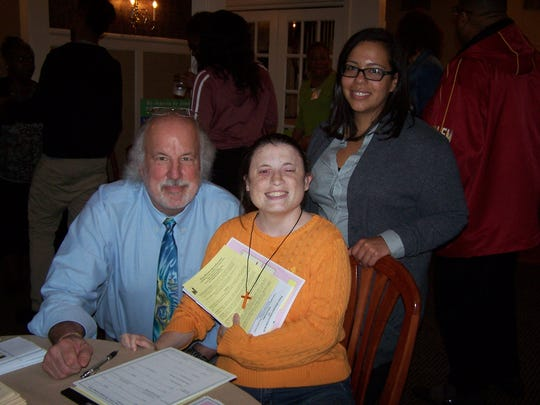 Margaret Carlos (center), a member of Community Access Unlimited, and Aisha Arroyo, an assistant executive director at the agency, met with Skip Winter of the First Presbyterian Church of Cranford at the speed networking event.