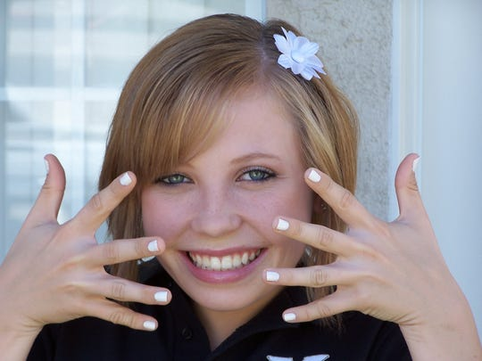 Madeline Muth shows off her freshly painted nails on one of her first days of high school. In middle school she wasn't allowed to wear nail polish to school, so she was excited to paint her nails, said Gigi Muth, Madeline's mother.