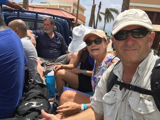 Brenda and Rick Fioretti on the back of a landscape truck in Sint Maarten.