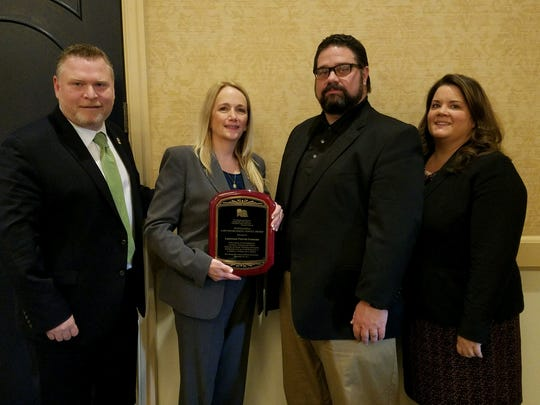 Union County Prosecutor's Office Lt. Patricia Gusmano displays her Outstanding Law Enforcement Service Award from the New Jersey Sex Crimes Officers Association. Appearing alongside Gusmano (from right) are Special Victims Unit Supervisor Caroline Lawlor, Assistant Prosecutor Michael Sheets and Sgt. Timothy Durkin.