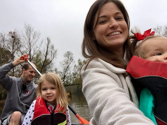 The Guidrys take a selfie in a canoe at Lake Fausse