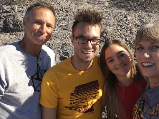 Sawyer's dad Jim, half-sister Savannah and mom Karina hike up A Mountain with Sawyer during Parents Weekend.