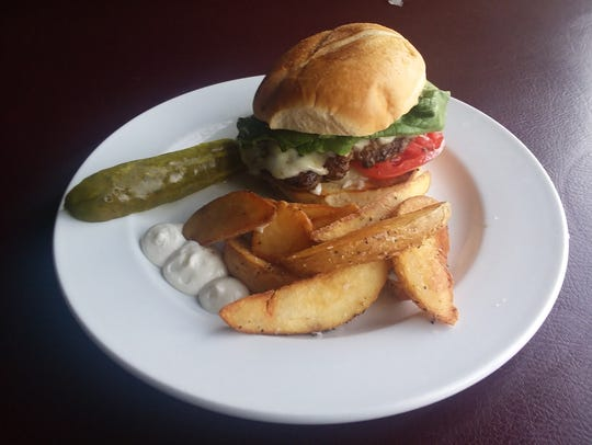 The Classic Burger with Brazilian fries at Cafe Beaudelaire