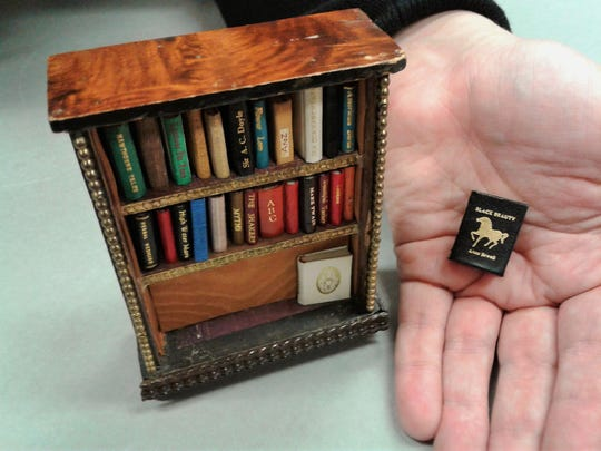 Some miniature books in the Charlotte Smith collection have dollhouse-sized bookshelves for storage and display. Classics by Nathaniel Hawthorne, Mark Twain and Arthur Conan Doyle are in this group.