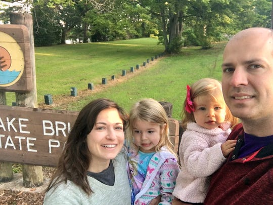 Travel and tourism reporter Leigh Guidry and her family are visiting all 21 Louisiana state parks. They stand in front of the sign of Lake Bruin State Park in St. Joseph. Follow the journey on Instagram (@thedailyadvertisesr) and at theadvertiser.com