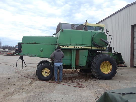 County Road crews restore a combine which will be part