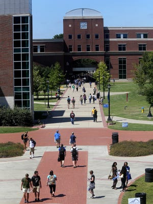 Middle Tennessee State University is the largest school in the Tennessee Board of Regents system, with 22,766 students. Students and others walk along the sidewalk near the Student Union on campus, Wednesday, Aug. 26, 2015.