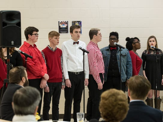 Student members of an a cappella group perform during