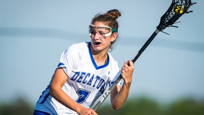 Stephen Decatur midfield Christina Romano (7) takes a shot against Huntingtown in the MPSSAA 3A Regional Finals at Stephen Decatur High School in Berlin on Monday, May 16.