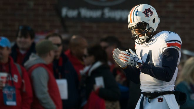 Auburn quarterback Nick Marshall (14) claps his hand before the NCAA football at University of Mississippi in Oxford, Miss., on Saturday, Nov. 1, 2014.