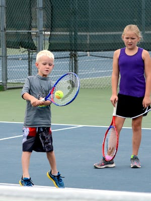Kelly Jurva, 6, works on his backhand swing Friday at Lake Carlsbad Tennis Complex.